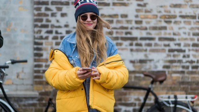 yellow puffer coat with blue denim jacket