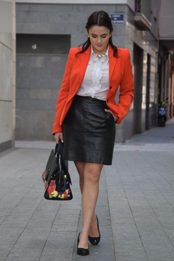 best orange jacket with white ruffle blouse and black leather mini skirt