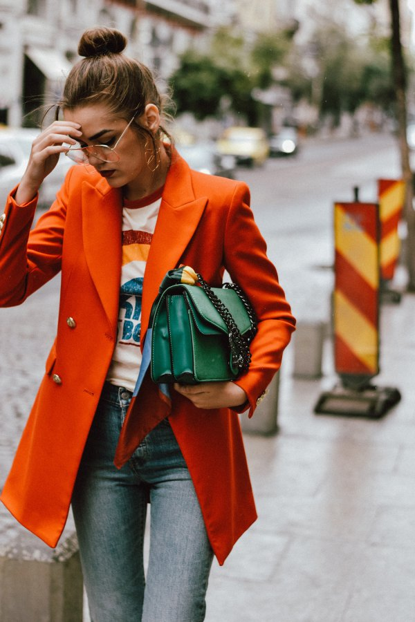 best orange oversized double breasted blazer with print tee and grey jeans
