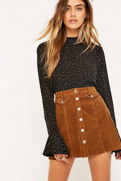 black and white polka dot bell sleeve blouse with brown mini skirt