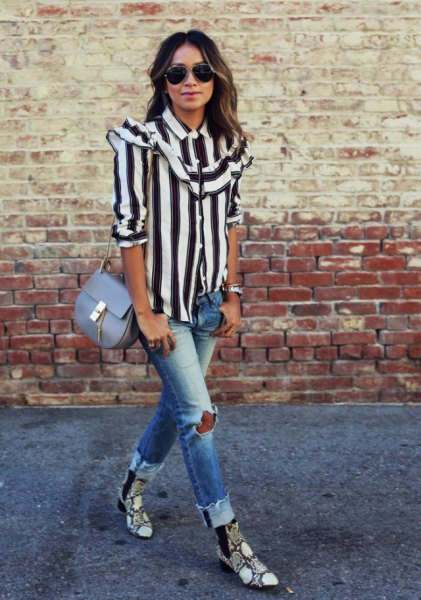 black and white striped button up shirt with ripped jeans