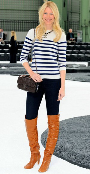 black and white striped knit sweater with tall jeans and orange boots