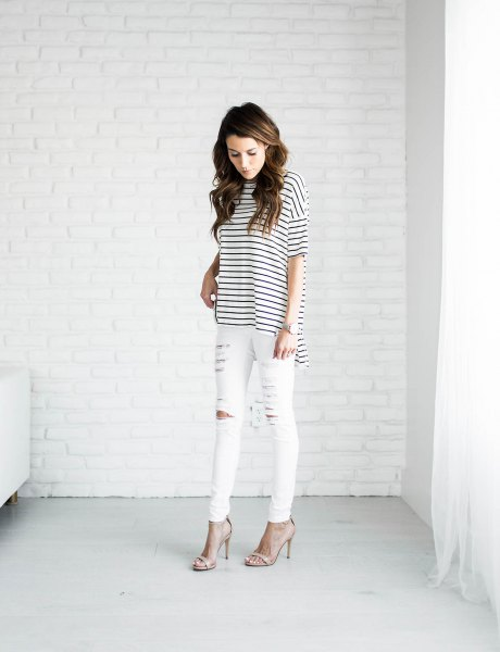 black and white striped t shirt and ripped white jeans