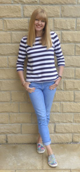 black and white striped tee with light blue cuffed jeans
