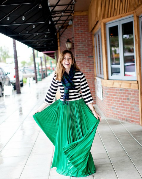 black and white striped three quarter sleeve tee with green pleated maxi skirt