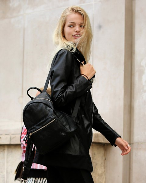 black bomber jacket with backpack and skinny jeans