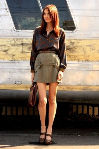 black button up shirt with green mini skirt