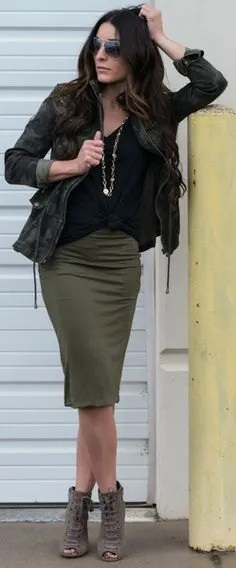 black camo jacket with olive green knee length skirt