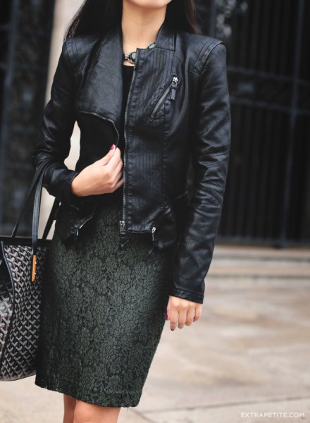 black jacket with knee length dark green embroidered dress