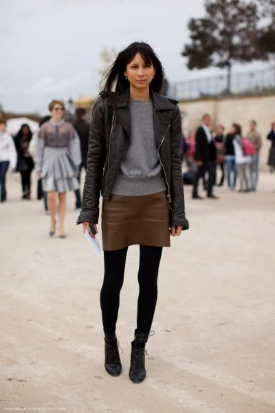 black leather jacket with dark mini leather skirt