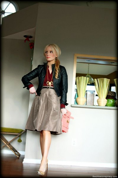 black leather jacket with grey knee length taffeta skirt