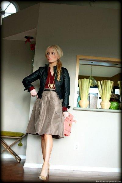 black leather jacket with grey knee length taffeta skirt