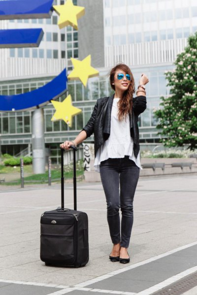 black leather travel blazer with white peplum blouse and jeans