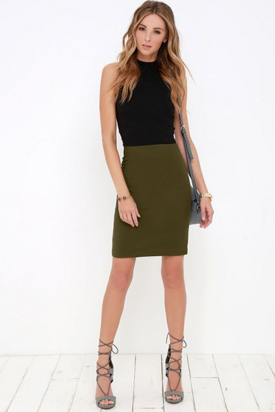 black mock neck sleeveless form fitting top with olive green mini skirt