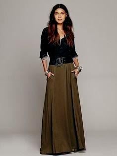 black scoop neck blouse with belted maxi green skirt