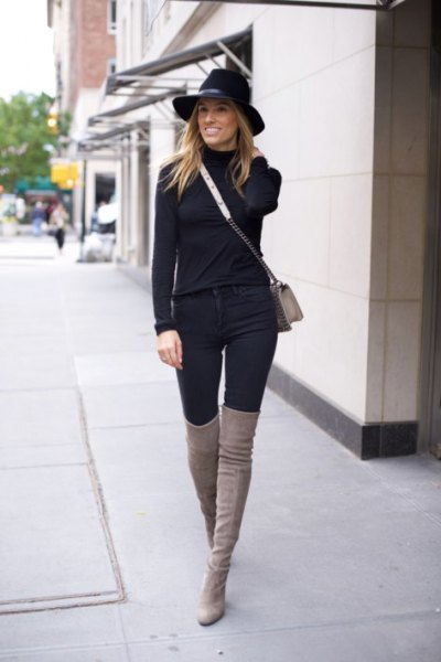 black sweater with matching tall jeans and grey thigh high boots