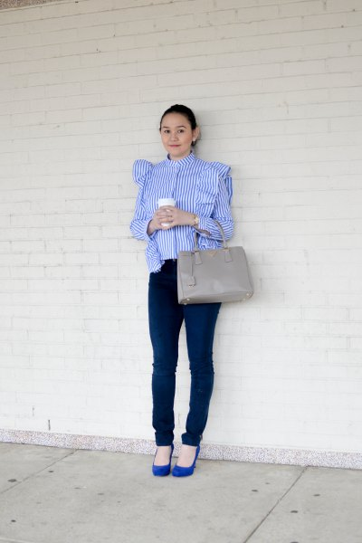 blue and white striped ruffle shoulder blouse with dark skinny jeans