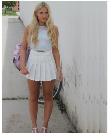 blue mock neck cropped top with white high rise mini pleated skirt