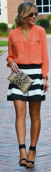 blush pink button up shirt with black and white striped mini pleated skirt