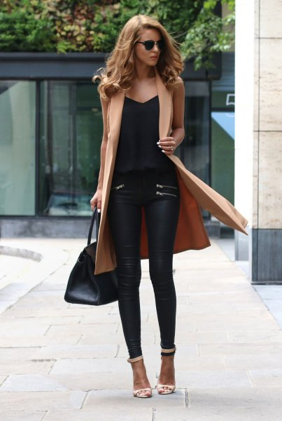 camel sleeveless longline jacket with black leather pants