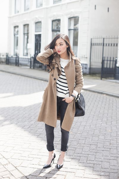camel wool coat with white and black striped sweater