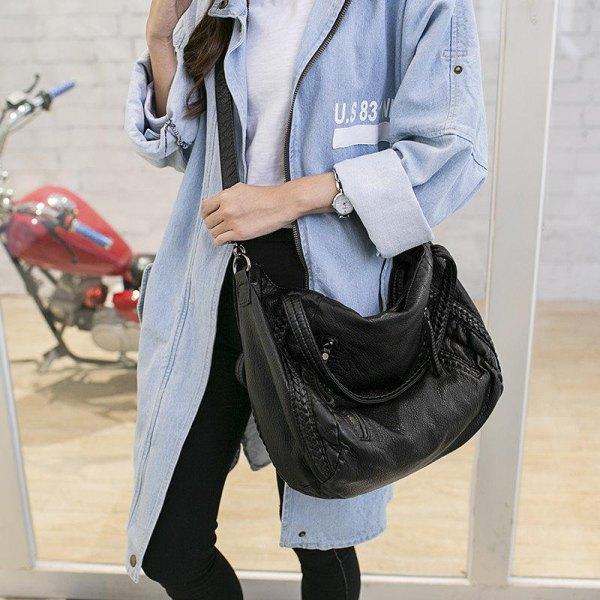 denim longline jacket with black skinny jeans and leather shoulder bag
