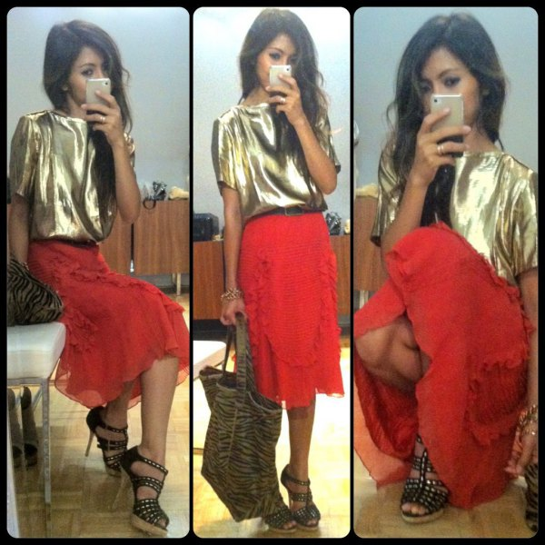 gold metallic short sleeve t shirt with red midi skirt