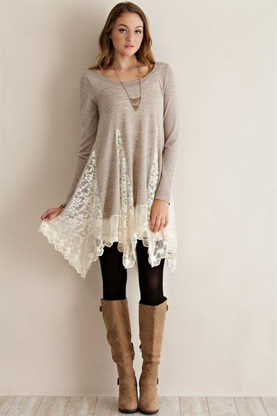 grey and white lace long tunic top with black leggings and knee high boots