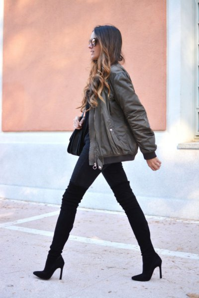 grey bomber jacket with black jeans and mid calf boots