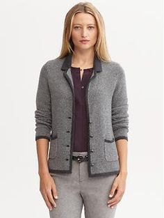 grey jacket with black blouse and wool pants