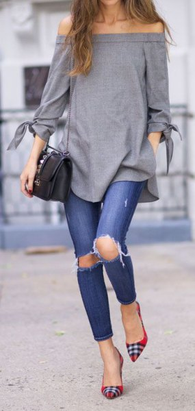 grey off the shoulder top with ripped jeans and red and black plaid flats
