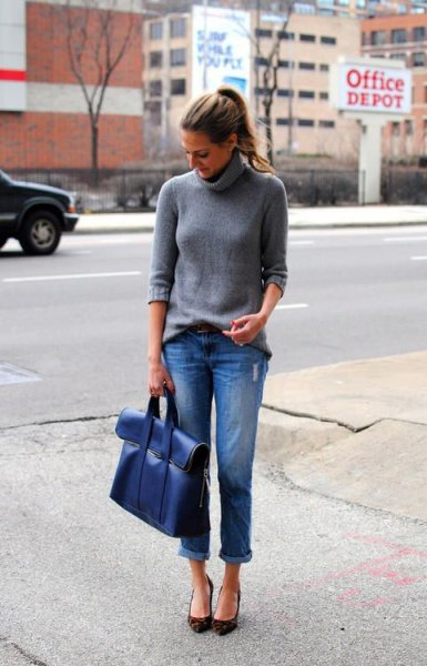 grey turtleneck knit sweater with blue cuffed jeans and matching briefcase