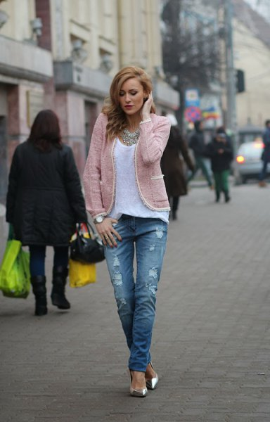 light grey jacket with white scoop neck top and ripped jeans