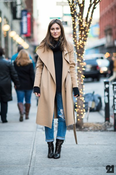 maxi camel longline jacket with black sweater and cuffed jeans