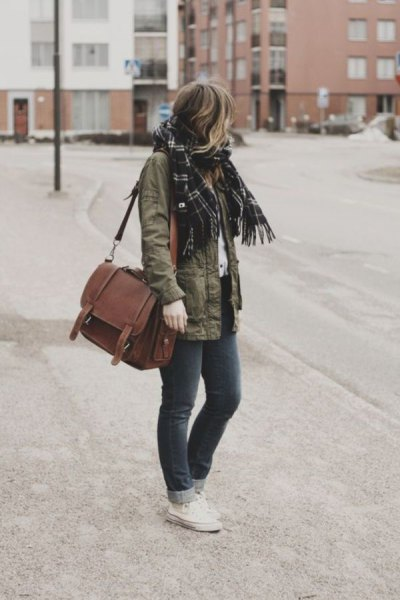 military jacket with black plaid scarf and brown suede messenger bag