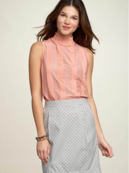 mock neck sleeveless blouse with black and white striped pencil skirt
