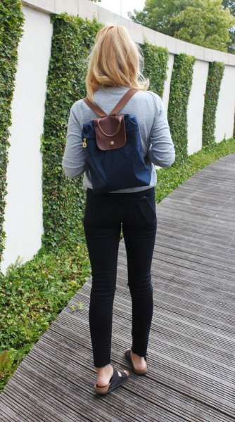 navy and brown backpack purse with grey long sleeve tee