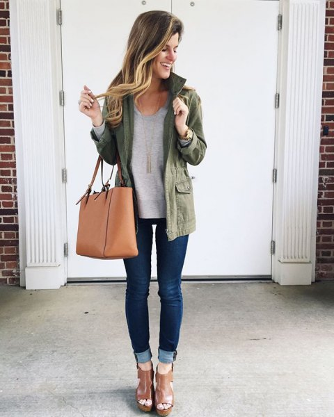 olive jacket with grey sweatshirt and cuffed dark blue skinny jeans