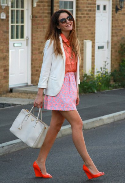 orange button up shirt with pale pink printed skirt and orange heels