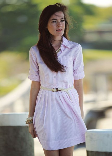 pale pink button up belted mini dress with silver statement necklace