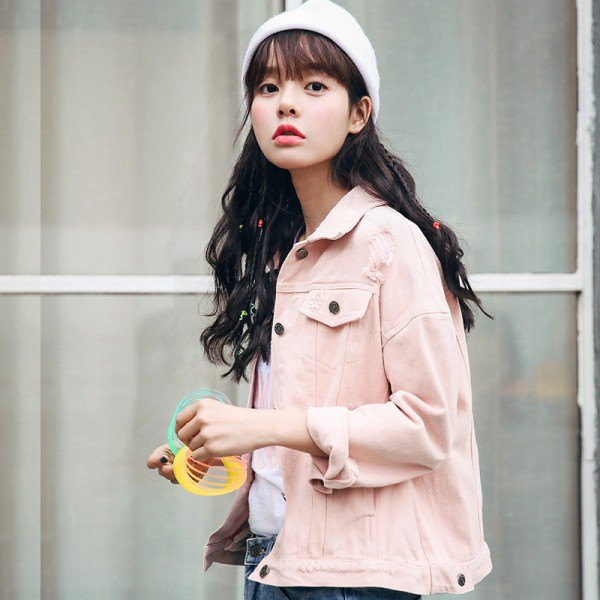 pale pink denim jacket with blue jeans and white knit hat