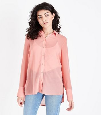 peach semi sheer button up shirt with light blue mom jeans