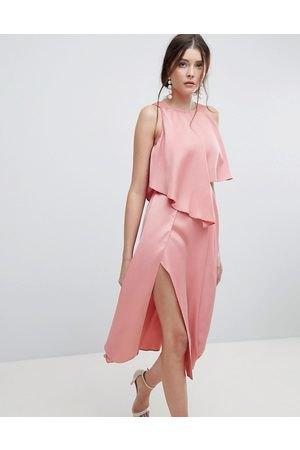 peach sleeveless blouse with matching high split midi skirt