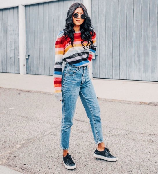 rainbow colored striped sweater with cropped mom jeans