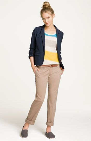 rainbow colored sweater with navy blue travel blazer and cropped pants