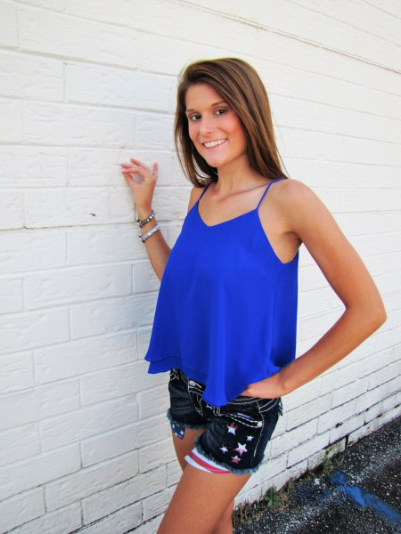 royal blue flowy tank top with black embroidered mini denim shorts