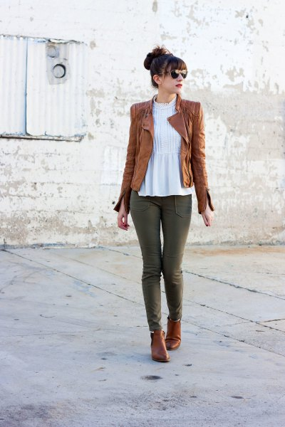 tank leather jacket with white peplum top and grey jeans