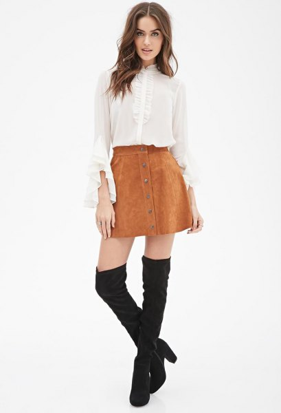 white bell sleeve chiffon blouse with mini suede skirt and thigh high boots
