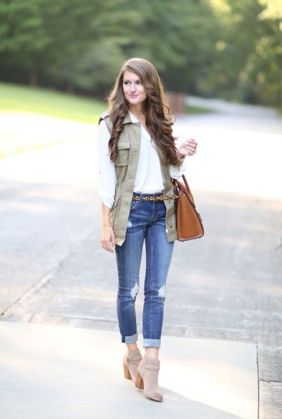 white blouse with light brown vest and grey ankle suede boots