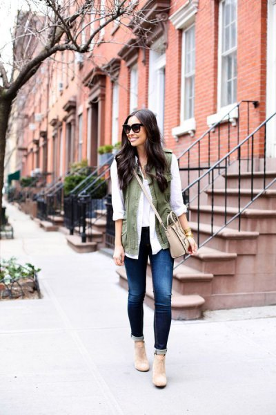 white chiffon blouse with olive green vest and pale pink shoulder leather bag